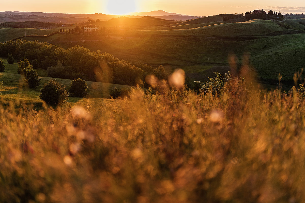 sunset over rolling hills in tuscany