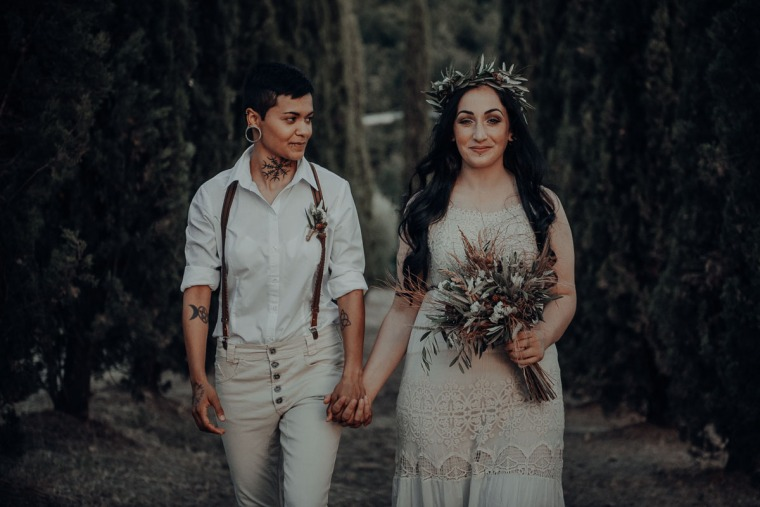 same-sex couple walking in nature tuscany