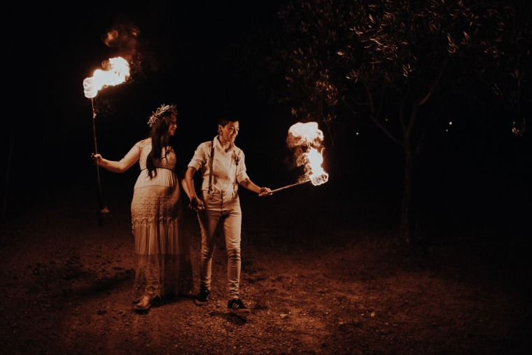 couple walking with burning flames