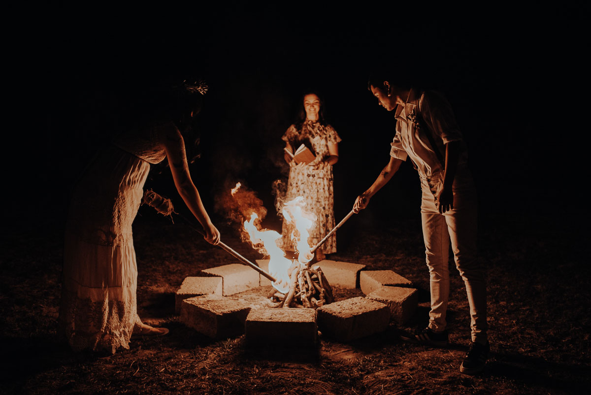 couple and celebrant at fire ritual ceremony in tuscany