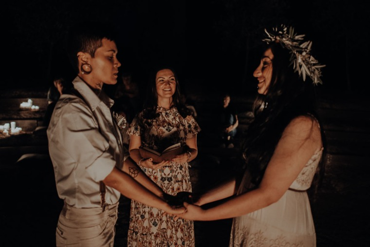 couple reading vows at ceremony in tuscany by night